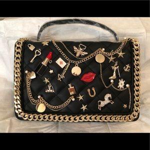 Black handbag with gold chain/black strap.
